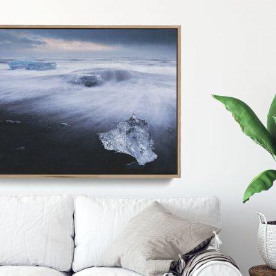 Ice crystals washing up on black sand beach Iceland